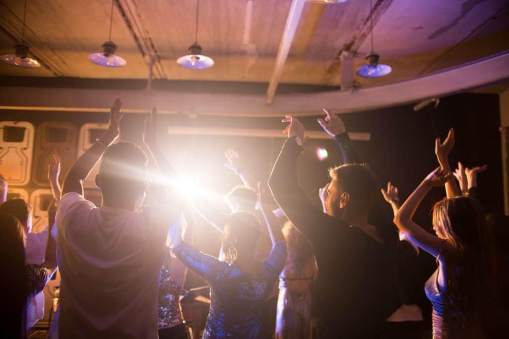 Crowd of Dancing People in Nightclub